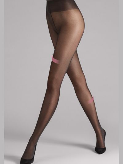 Sheer supporting black wolford tights